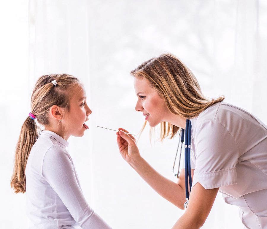 Doctor with kid for a checkup