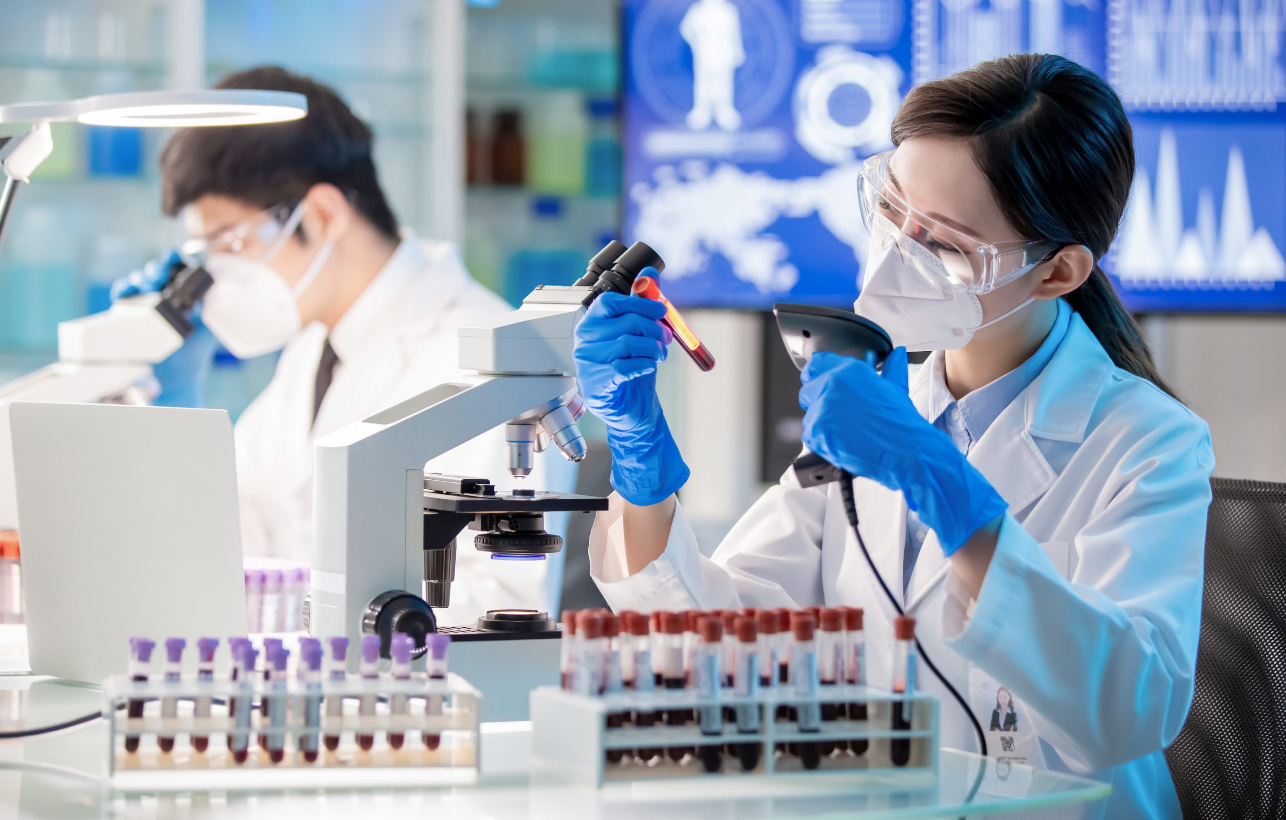 young female physician analyzes blood sample a